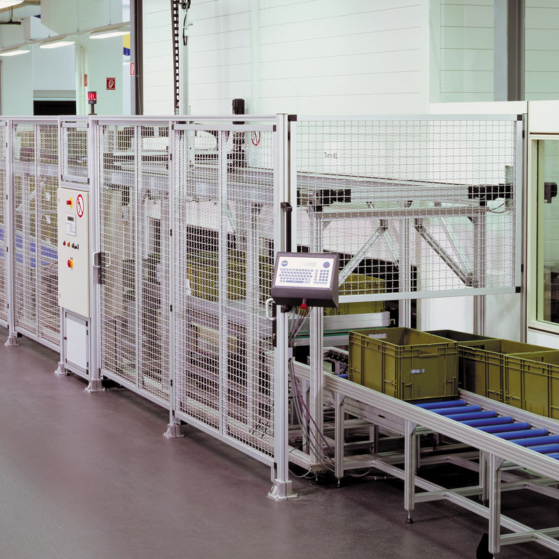 Protective grating around a double door system to a high rack